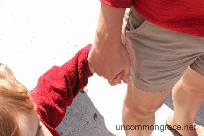 UG Holding Hands